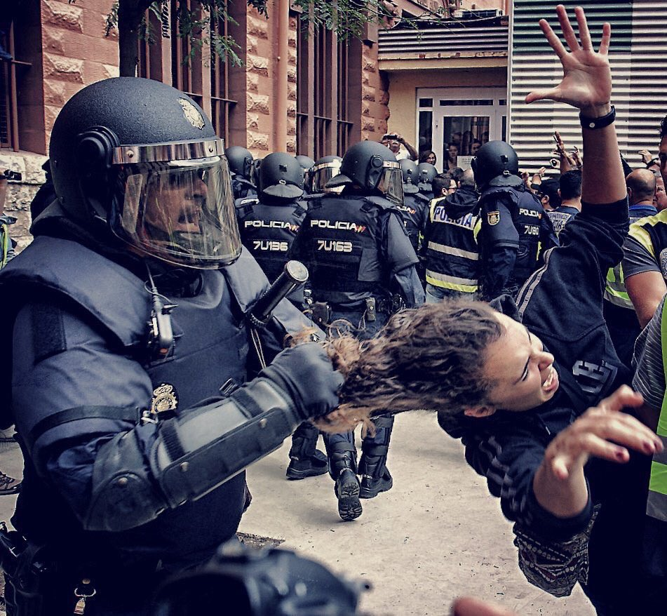 This image has an empty alt attribute; its file name is Catalonia-Police-Brutality-2.jpg
